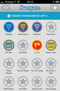 Ecran des badges de l'application iPhone Foursquare